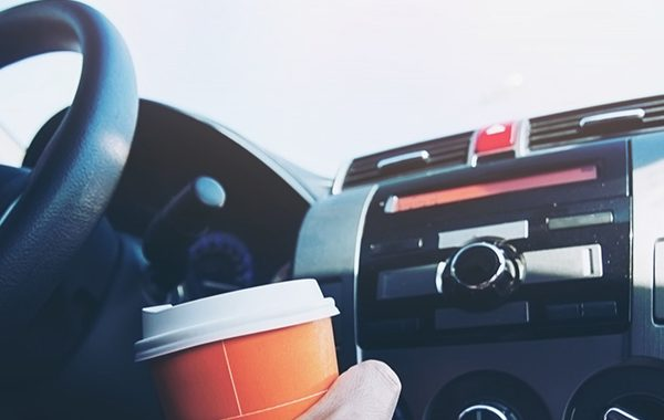 man-drive-car-while-holding-cup-of-hot-coffee-car-driving-sleepy-or-asleep-concept copia
